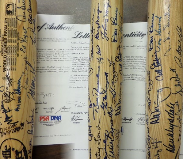 This Greatest World Series Rivalry engraved bat from Louisville Slugger shows results from every Dodgers/Yankees World Series ever played, and comes hand-signed by 42 different players who starred for both iconic MLB franchises.  Included are HOF'ers like Pee Wee Reese, Don Drysdale, Catfish Hunter, Duke Snider, Yogi Berra, Whitey For, Phil Rizzuto, Tom Lasorda, Johnny Mize and Don Sutton, as well as notables like Bauer, Camilli, Nettles, McDougald, John, Erskine, Roe, Larsen, Wills, Labine, Podres, Skowron, Richardson, Pafko, Henrich, Reynolds and Dent!  Comes with a full PSA/DNA letter of authenticity, and with so many of these greats now deceased, retail is well up into the thousands!