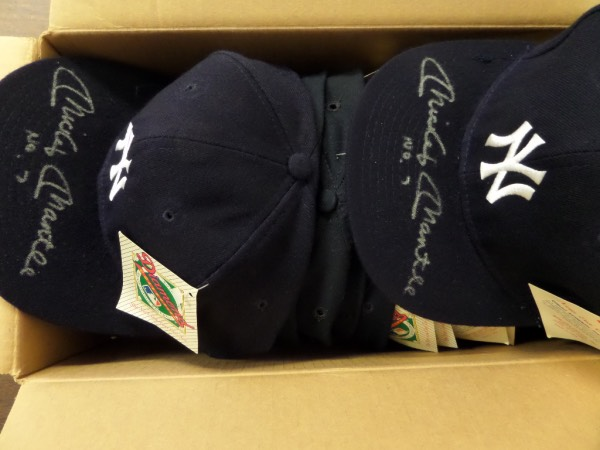 This amazing opportunity is perfect for dealers ... or somebody with a lot of friends who are Yanks fans!  It is FIFTEEN fitted navy blue New York Yankees caps, each still with original New Era Diamond Collection tags affixed, and EACH is brilliantly penned in silver on the top of the bill by Yankees all time great, Mickey Mantle!  Fantastic-looking signatures here, each grading from 7-9, and each including his No. 7 inscription as a bonus!  Just one of these babies can retail into the mid hundreds by itself, and we're starting you out with a $3.00 per hat minimum!  Some serious coin can be made here!!!