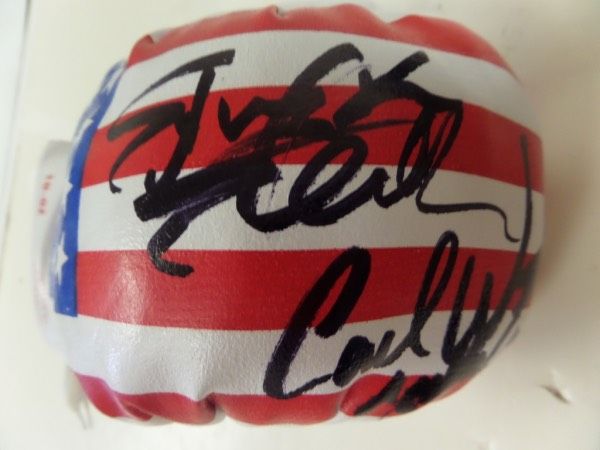 "This mint 10 ounce USA glove has been signed by BOTH of these ROCKY stars superbly in black. Carl has even included ""Apollo Creed"" with his signature! IDeal for the classic movie and sports collector and retails in the mid-high hundreds."