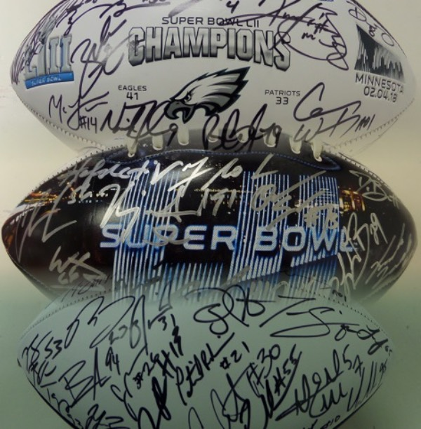This absolutely STUNNING collector's item is a Super Bowl LII Champions logo half white and half black panel football, hand-signed all over in black and silver by more than 35 members of the reigning champs!  Included are all of the big and important names, like Peterson, Wentz, Foles, Blount, Jeffery, Barnett, Clement, Brooks, Cox, Jurnigan, Graham, Long, McLeod, Jenkins, Ajayi, Ertz and more.  A fantastic Eagles item, and retail is low thousands!