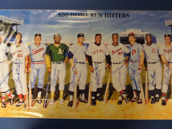 This 1989 color poster is 3x4 feet in size and shows all 11 HOF sluggers posing, inside Yankee Stadium, and in their vintage 1950-70's uniforms. Great piece from noted sports artist Ron Lewis and signed by everyone in bold blue sharpie. Even Mays signed in blue!!! Great item, matted in blue and value is thousands with high value autographs from Ted Willams, Mickey Mantle, McCovey, Banks, Reggie, Schmidt, Mays, Aaron etc. Wow..