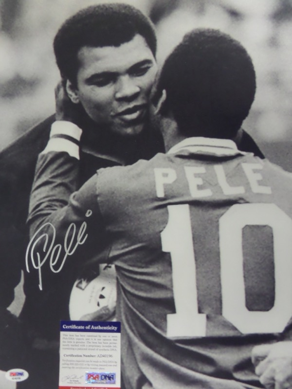 This HUGE black and white 16x20 photo shows soccer legend, Pele, embracing three time Heavyweight Champion, Muhammad Ali.  It is beautifully-penned in silver by the all time pitch great himself, and comes fully PSA/DNA certified (AD40196) for authenticity purposes.  A gorgeous display photo, ideal size for framing, and retail is well into the hundreds!