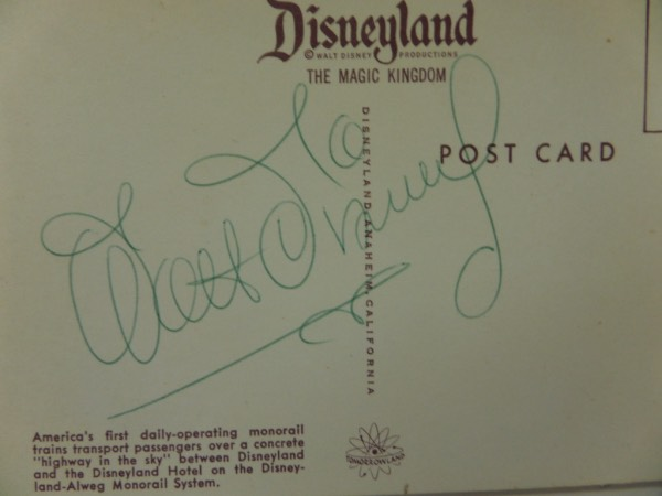 This very rare 1961 era color postcard is the normal 4x6 in size and shows the theme parks monorail on the front, and a superb green ink autograph from Walt on the back. The signature is a bold flowing gem, ok'd by Lee himself for certainty, and value is 2 grand we believe on the historic Calf. piece of yesteryear. Go ahead, try to find another one.