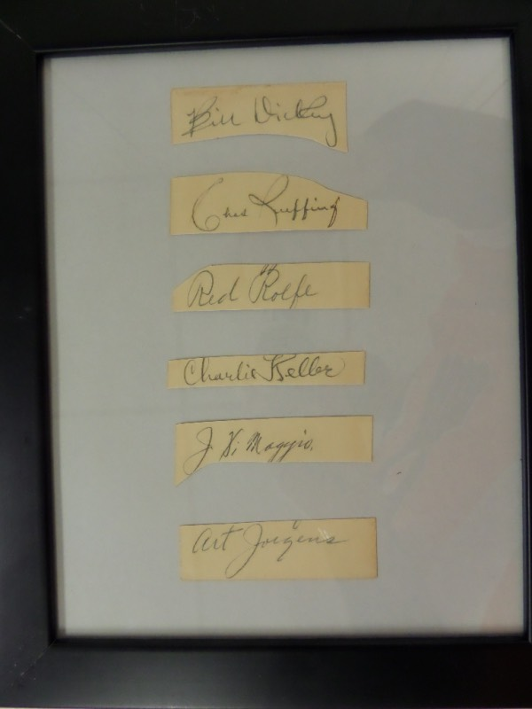 "This wood framed display is about 11x14 in size and holds SIX black ink signatures from stars of the past. Great work, guaranteed to pass any authenticity test, and value is many times our asking price. An honest overall grade is a 7-8 and signers include the earliest DiMaggio signature we have ever seen, as well as Charlie Keller, Bill Dickey, Red Rolfe, Red Ruffing and Art Jorgens. Cool piece, rare one of a kind, and a must have for all ""Bronx Bombers"" collectors."