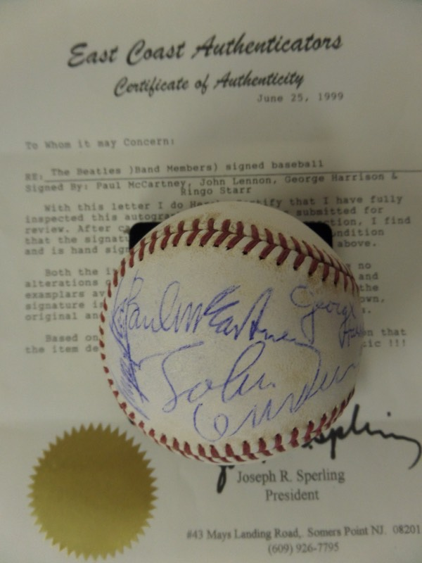 This vintage Official National League ball from Spalding is still in EX condition overall, and comes blue ink-signed by ALL FOUR BEATLES!!!  All four signatures have worn fairly evenly with the ball, grading 5.5-6's each, and all four reside on the same panel, making it an ideal display ball.  Comes certified by East Coast Authenticators, and retail is well into the thousands!