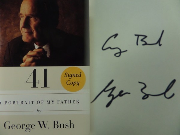 "This mint hardback is ""41-A Portrait of My Father"" and includes the color dustjacket showing the just deceased 41s US President. It is a great read, labeled on the front by the book store as a ""signed cop"" and comes black marker signed by BOTH George H and George W. Bush.  Value is $1200.00, ""Great American"" buy and hold investment is an easy one here, and just look at the always low opening bid price."