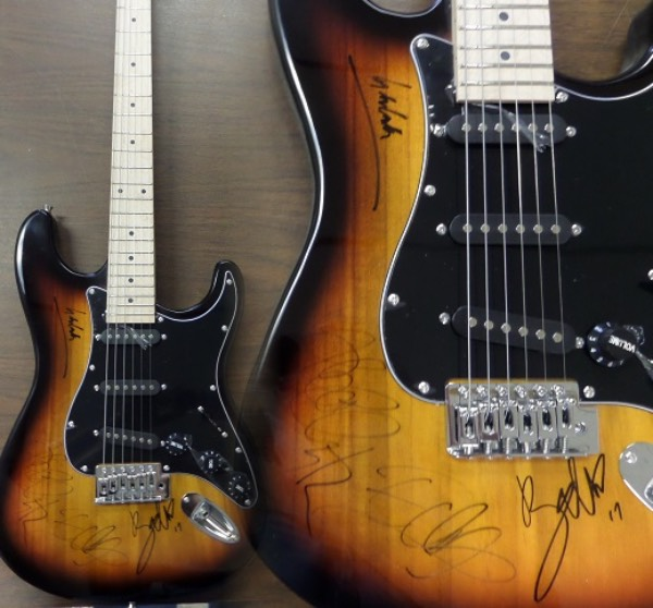 This beautiful 2-tone electric guitar is in MINT condition, and comes body signed in black  sharpies by all four members of this longtime hit band.  Included are Adam Clayton, The Edge, Bono, and Larry Mullen, and the guitar is valued into the low thousands! Comes in original box with bag, cords, etc... and perfect for display. WOW