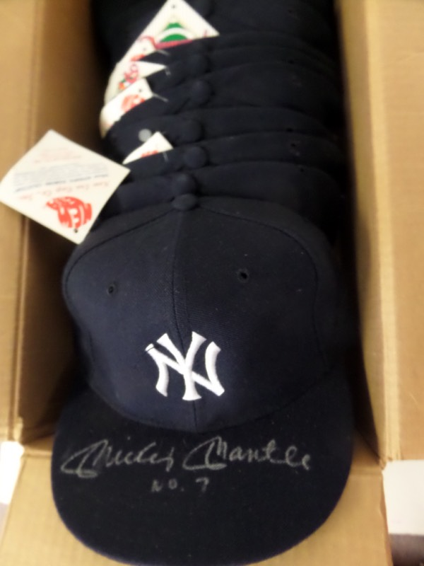 This amazing opportunity is perfect for dealers ... or somebody with a lot of friends who are Yanks fans!  It is TEN fitted navy blue New York Yankees caps, each still with original New Era Diamond Collection tags affixed, and EACH is brilliantly penned in silver on the top of the bill by Yankees all time great, Mickey Mantle!  Fantastic-looking signatures here, each grading from 7-9, and each including his No. 7 inscription as a bonus!  Just one of these babies can retail into the mid hundreds by itself, and we're starting you out with a $3.00 per hat minimum!  Some serious coin can be made here!!!