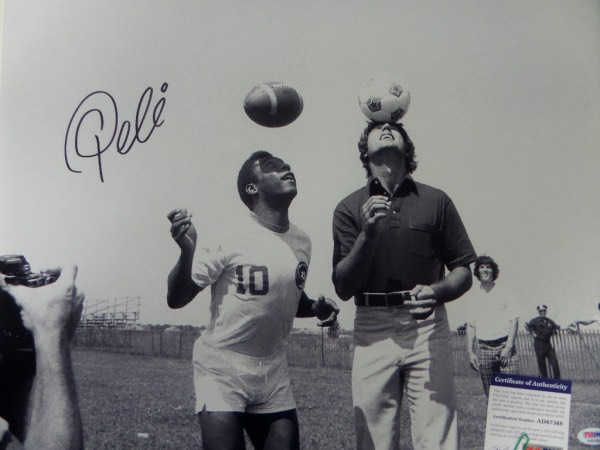 This large black and white 16x20 photo shows Pele heading a football next to Jets HOF QB Joe Namath, who is heading a soccer ball.  It is hand-signed in bold black sharpie by the all time soccer great himself, grading a nearly flawless 9.5, and is fully PSA/DNA certified (AD67368) for authenticity.  Valued well into the hundreds!