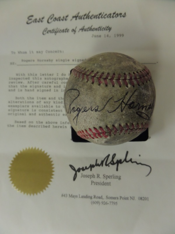 This red-laced, vintage baseball is unmarked and in F condition overall.  It has been hand-signed against the sweet spot in fountain pen ink by the two time Triple Crown winner himself, and includes a COA from East Coast Authenticators for authenticity purposes.  Valued into the thousands!
