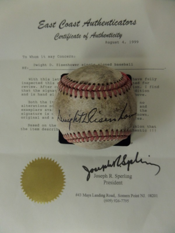 This vintage red-laced baseball comes to us in F+/G overall condition, with much age evident.  It is hand-signed across the sweet spot in black by 34th United States President and former Supreme Commander of the Allied Forces, Dwight Eisenhower, grading a solid, legible 7.  Comes with a COA from East Coast Authenticators for certainty, and retail is well into the thousands on this gem!