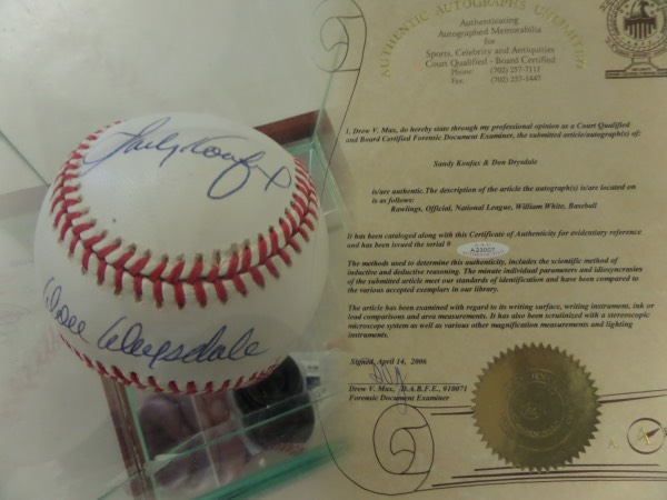"This Official National League ball from Rawlings sits in a gorgeous wood based glass presentation case, and is blue ink-signed by one of the greatest pair of pitching teammates in MLB  history.  Included are Sandy Koufax on the top panel and Don Drysdale on the sweet spot, both LA Dodgers HOF Greats, and the ball includes a full LOA from ""AAU"" for authenticity purposes.  Valued well into the hundreds!"