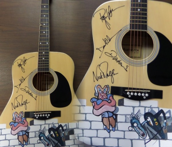 "This acoustic guitar from Huntington is in excellent overall condition with a completely original hand painted artist's depiction of ""The Wall""!  It was hand signed in person for our consignor by all four band members in black sharpie, including Richard Wright (dec), Nick Mason, Roger Waters, and David Gilmour!  All four signatures rate between 9's or better on this unique guitar worth high hundreds, easily!"