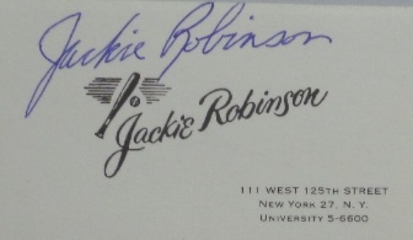 This vintage Jackie Robinson business card is in NM condition, and comes hand signed in blue ball point pen ink by the great Brooklyn Dodgers HOF'er and pioneer.  His signature is very clean, grading a legible 8, and will make for a wonderful display on one of his very own business cards.  Valued into the high hundreds!