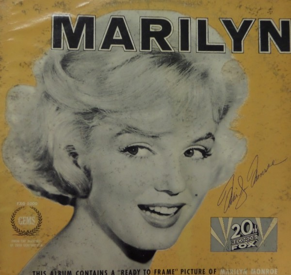 "This vintage ""Marilyn"" LP album from 20th Century Fox Records is in G+/VG overall condition, with a close up black and white image of Marilyn Monroe on the front cover.  It is hand-signed to the right of said image in blue ink by the Hollywood megastar herself, grading a legible 6.5, and with her death now well over a half century ago, this RARE item is valued well into the thousands!"