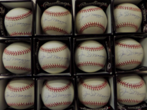 This fantastic dealer's opportunity is ONE FULL DOZEN Official American League Rawlings baseballs, each penned on the sweet spot in blue ink by the one and only Joltin' Joe himself, Yankees icon and HOF legend, Joe DiMaggio!  Each ball in here grades between VG+ and EX+, and each signature is a legible 8 or better.  Each ball has a book value at no less than $600.00, so you do the math.  This is the last DOZEN opportunity we have, so this really is your last chance for this incredible investment!