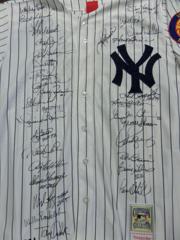 This amazing, mostly card show obtained gem is a 10 all over, and signed by 30 in bold black sharpie. The jersey is a home white pinstripe, tagged by Mitchell & Ness from the 1990's, and has Mickey Mantle's #7 sewn on back. I see strong autographs from the likes of stars, fan faves and HOF'ers, including Ford, Clemens, Mattingly, Torre, Winfield, Rivera, Berra, Jeter, Pettitte, Boggs, Goose, Kubek, Larsen, Reggie Jackson, Arod, Steinbrenner and many, many more! Wow!! Value might be 4 grand on this pinstripe treasure.