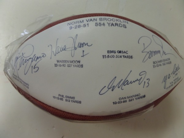 This custom Wilson NFL leather football has one white panel, which lists the 8 quarterbacks who, at the time, were the only to throw for 500 yards in a single game.  It is hand-signed by 5 of the 8, including Dan Marino, Y.A. Tittle, Warren Moon, Boomer Esiason and Vince Ferragamo.  A fantastic collector's and display item, 100% guaranteed authentic, and retail is well into the hundreds!