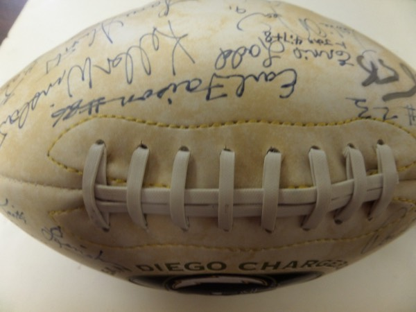 This San Diego Chargers, Established 1960 team logo 1/2 white panel football is a limited edition ball of 10,000, in NM condition, and features team championship info.  It is hand-signed by 12 of the greatest to ever play for the franchise, plus longtime team owner George Pernicano.  Included are HOF'ers Dan Fouts, Lance Alworth, Kellen Winslow, Ron Mix, Charlie Joiner, Junior Seau, and notables, Leslie O'Neal, Paul Lowe, Chuck Allen, Keith Lincoln, Earl Falson, and Ernie Ladd.  With 5 now deceased, and super duper HOF star power, this MUST HAVE Chargers collector's item is valued well into the mid/high hundreds!