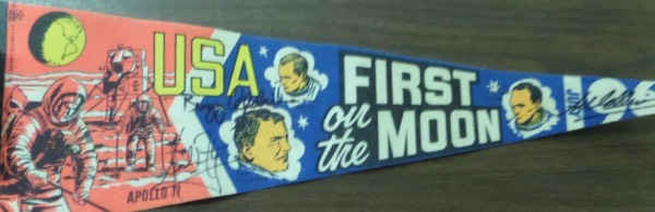 This super rare, late 1969 USA sold pennant is old school felt, full color, and in fine or better condition. It honors the 3 men who walked first on the moon, comes black marker signed by Buzz Aldrin, Michael Collins and Neil Armstrong, and value is thousands on the possible, one of a kind Great American must have. It is a super rare piece even before they all signed it, and comes in the medium size.