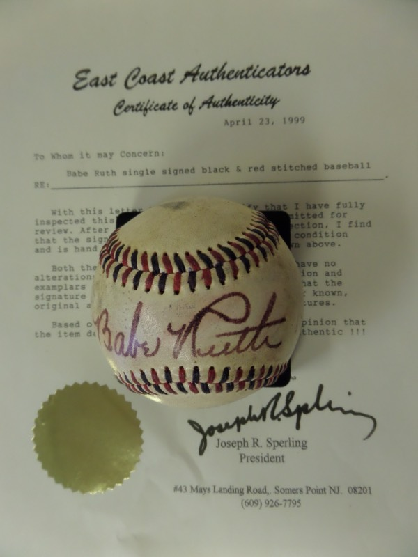 This vintage red and blue-stitched baseball is in G+ overall condition, and comes hand-signed across the sweet spot by the great Babe Ruth!  Signature is a slightly bled 6-6.5, and the ball comes with a COA from East Coast Authenticators.  Valued well into the thousands, with a low, low minimum bid evident!
