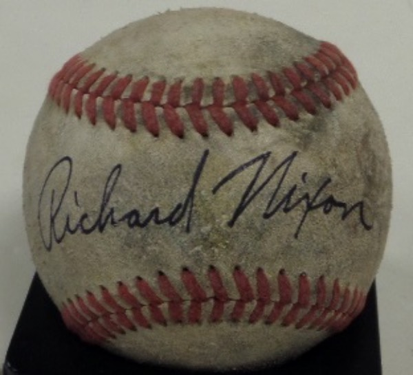 This vintage red-laced baseball is aged and weathered, and in F+ overall condition, but it is fabulously blue ink-penned across the sweet spot by 37th United States President, Richard Nixon.  The autograph is a bold, legible 8 overall, and with the former Commander In Chief deceased now for many years, retail is well into the hundreds!