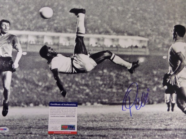 This large black and white 16x20 photo shows soccer legend Pele in a mid air bicycle kick.  It is hand-signed boldly in blue sharpie by the all time great himself, grading a strong 9 overall, and comes certified by PSA/DNA (AD 21730) for authenticity purposes.  A MUST for any soccer collection, and valued well into the hundreds!