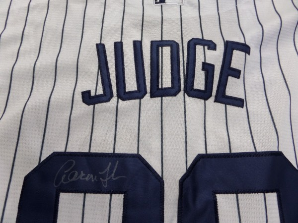 This authentic-style home Yanks pinstripe comes signed on the back #99 by this young slugger in silver. Great signature from this up and coming superstar and high retail value.