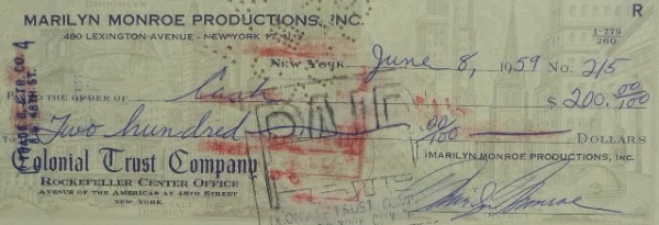 This vintage check is all original and on her Marilyn Monroe Productions account and in NM shape! It comes fully endorsed and postmarked and has been signed on the front in blue ink and on the back in black ink by Marilyn herself! Book value well into the thousands