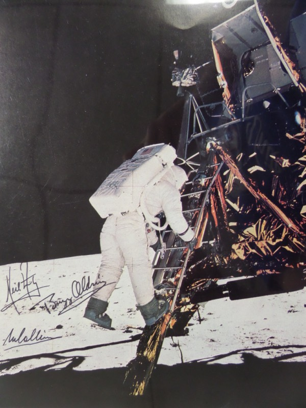 This gorgeous, full color 11x14 photo of Buzz Aldrin descending the lunar module is direct from NASA, in NM/MT condition, and comes hand signed by all three men who were the first to see it up close.  Included are Buzz Aldrin, Neil Armstrong and Michael Collins, all in black sharpie and grading gorgeous 8.5's and above, and this piece will frame exquisitely for any collection!