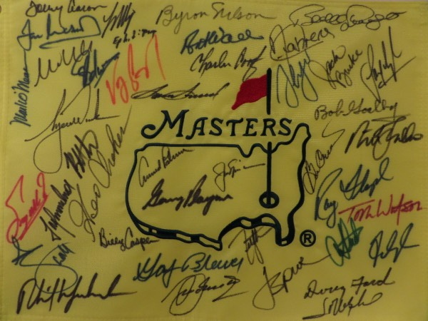 This custom, professional, and full-sized pin flag is yellow, embroidered in red and green colors, and comes sharpie signed by over 30 past winners. I see some amazing HOF names, guys like Arnold Palmer, Jack Nicklaus, Gary Player, Byron nelson, Sam Snead, Ray Floyd, and even some guy named Tiger Woods. It grades a 9-10 all over, value is middle thousands, and although we have sold 17 of them now, we have NEVER had one returned!