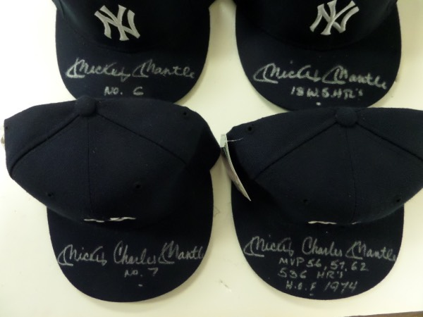 This fantastic and unique grouping totals FOUR New York Yankees MINT/fitted baseball caps from New Era, each with original tagging attached, and each is hand-signed on the bill by the icon of icons, the great Mickey Mantle.  Each signature is in silver, grading at least a legible 8, and each features a different inscription.  Included are Mickey Charles Mantle No. 7, Mickey Mantle No.6, Mickey Mantle 18 WS HR's, and the capper, Mickey Charles Mantle MVP 56,57,62, 536 HR's, HOF 1974!  WOW!  You KNOW these caps can easily retail into the mid hundreds each, so get in our our $20 minimum!