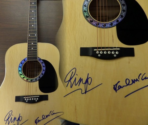 This stunning acoustic guitar from Huntington is boxed in MINT condition, and comes hand-signed on the body in blue sharpie by the two living Beatles, Paul McCartney and Ringo Starr.  Signatures grade bold, clean, legible 9's at least, and this baby will make for a fabulous Hard Rock-style display.  Valued into the thousands, with a low, LOW minimum bid present!