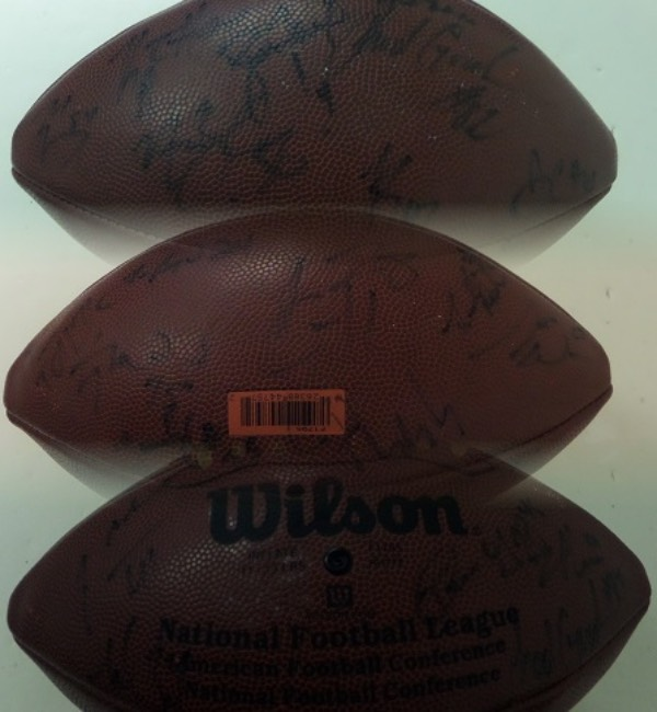 This seldom seen item is a full size Wilson football, still in EX/MT shape, and hand-signed all over in black sharpie by more than 25 members of the Super Bowl XXXI Champion Green Bay Packers!  Signatures are faded due to the passage of more than two decades, grading mostly 4's-5's, and included are Brett Favre and a whole bunch of others--please see our attached photos, and maybe you can make out some more!