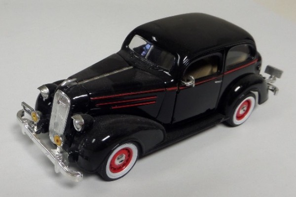 "This STUNNING collector's item is part of the July 2019 Coach's Corner ""Carfest!""  It is a MINT 1:32 scale beautiful replica of a 1936 Chevrolet Standard Town Sedan, with fabulous attention to detail, and sits in a NM lucite case for display.  A MUST for collectors, and retail is into the hundreds!"