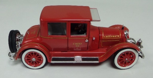 "This STUNNING collector's item is part of the July 2019 Coach's Corner ""Carfest!""  It is a MINT 1:32 scale beautiful replica of a 1918 Cadillac Fire Chief's Car, with fabulous attention to detail, and sits in a NM lucite case for display.  A MUST for collectors, and retail is into the hundreds!"