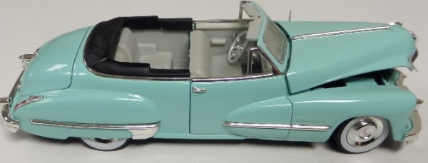 "This STUNNING collector's item is part of the July 2019 Coach's Corner ""Carfest!""  It is a MINT 1:32 scale beautiful replica of a 1947 Cadillac Series 62 Soft Top convertible, with fabulous attention to detail, and sits in a NM lucite case for display.  A MUST for collectors, and retail is into the hundreds!"