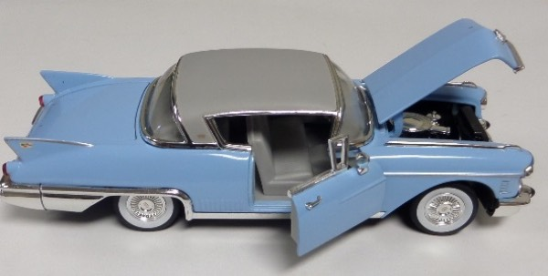 "This STUNNING collector's item is part of the July 2019 Coach's Corner ""Carfest!""  It is a MINT 1:32 scale beautiful replica of a 1958 Cadillac El Dorado Series 62, with fabulous attention to detail, and sits in a NM lucite case for display.  A MUST for collectors, and retail is into the hundreds!"