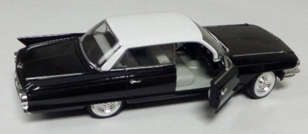 "This STUNNING collector's item is part of the July 2019 Coach's Corner ""Carfest!""  It is a MINT 1:32 scale beautiful replica of a 1961 Cadillac Sedan DeVille, with fabulous attention to detail, and sits in a NM lucite case for display.  A MUST for collectors, and retail is into the hundreds!"
