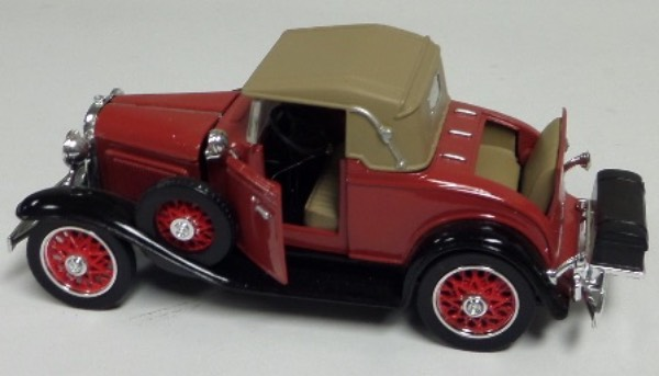 "This STUNNING collector's item is part of the July 2019 Coach's Corner ""Carfest!""  It is a MINT 1:32 scale beautiful replica of a 1931 Chevrolet Sports Cabriolet, with fabulous attention to detail, and sits in a NM lucite case for display.  A MUST for collectors, and retail is into the hundreds!"
