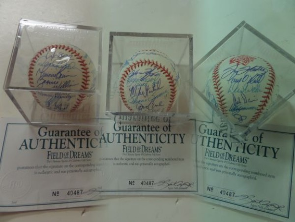 This $2500.00 ball has an original Field of Dreams lifetime LOA and hologram included and is blue ink signed by everyone, and on an official 1998 World Series baseball. I see at least 27 signatures, grade is an 8 or better all over, and signees include Torre, Martinez, O'Neill, Wells, Zimmer, Pettitte, Posada, JETER, Bernie, Rivera and many, many more terrific Big Apple opportunity, and sold here with NO reserve!