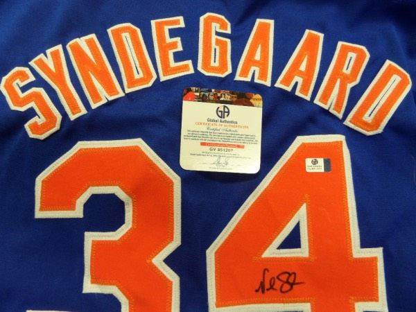 This blue L/XL custom New York Mets Syndergaard #34 jersey is in NM condition, and has everything sewn.  It is back number-signed in black sharpie by the Mets' ace righty himself, and comes with a COA from Global Authentics (GV851207) for certainty.  A fantastic Mets collector's item, ready for framing and display, and retail is mid/high hundreds, to be sure!