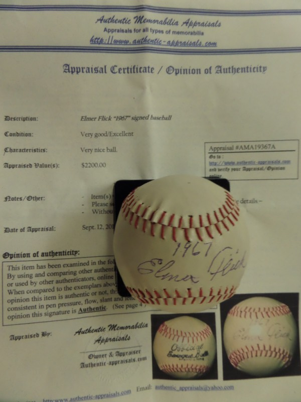 "This vintage ""Official League Ball"" is in VG+/EX condition, and comes sweet spot-signed in black ink by HOF Indians outfielder, Elmer Flick.  The signature grades an overall 5.5, including a 1967 dated inscription, and the ball comes with a COA from Authentic Memorabilia Appraisals, which assesses the value at $2200.00!"