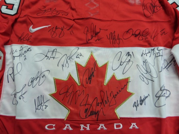 This red XXXL Team Canada #99 Gretzky jersey is from Nike, and comes to us trimmed in white, in NM condition, and with everything sewn.  It is front-signed in black sharpie by the star-studded 2002 Gold Medal-winning Canadian hockey team, including Gretzky himself, Ed Belfour, Rob Blake, Martin Brodeur, Theo Fleury, Simon Gagne, Jerome Iginla, Curtis Joseph, Ed Jovanoski, Paul Kariya, Mario Lemeiux, Eric Lindros, Al McInnis, Scott Niedermayer, Steve Yzerman, Brendan Shanahan, Joe Sakic, Chris Pronger and more.  That's some TRUE HOF power on one jersey, and retail is well into the thousands!