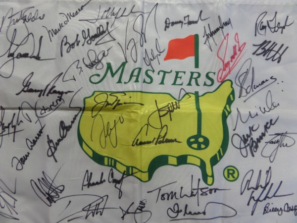 This white Masters logo pin flag is in NM/MT condition, and comes hand-signed all over by 35 former winners.  Everyone except for Fuzzy Zoeller--red--is in black sharpie, and included are Nicklaus, Spieth, Palmer, O'Meara, Player, Woods, Cabrera, Watson, Casper, Mickelson, Weir, Singh, Palmer, Watson, and many more, and this baby will frame and display brilliantly for any golf collection.  Valued WELL into the thousands!