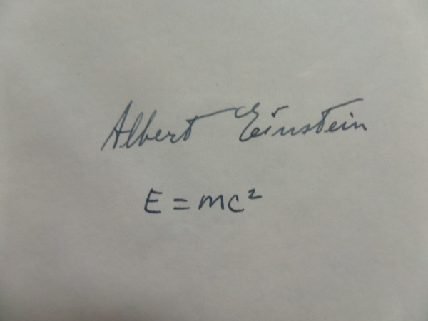 This almost 4x6 cut of white paper is in NM condition, and comes hand-signed boldly in black fountain pen ink by scientific genius, Albert Einstein.  This is a very bold, well-kept signature, grading a solid legible 6.5, and including his famed E=MC2 equation, and with his death now more than 60 years ago, retail here is very high hundreds!