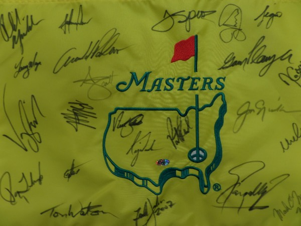 This unbelievable display piece is a MINT condition yellow embroidered Masters pin flag that comes hand signed in black sharpie by 23 Champions of the famed major!  Included are Woods, Player, Faldo, Arnold Palmer, Nicklaus, Crenshaw, Watson, Floyd, Singh, Mickelson, Reed,Spieth,Sergio, and so many more, and this piece will show off fabulously in any golf collection! WOW! Retails well into the thousands