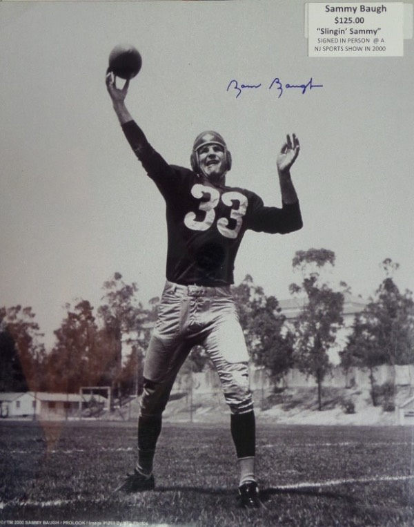 "This large 16x20 photo is a black and white image of ""Slingin' Sammy,"" letting go of a pass in his Washington Redskins uniform.  It is blue sharpie-signed by the HOF'er, record-breaker, and all time great himself, grading a super duper clean 9 or better, and was signed in person at a New Jersey sports show, back in 2000.  A great looking photo to frame and display, and a proud addition to any football collection!"