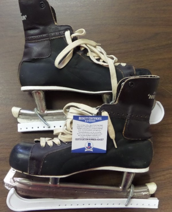 "This lot is worthy of display in the Hockey HOF and is a GU pair of Bauer ice skates from the 1972 season. They show great usage from the HOF Great, come with proper Beckett authenticity, and one comes signed by Barber in silver, and noted as ""1972 Game Used"". Cool chance, and value is $1400.00."
