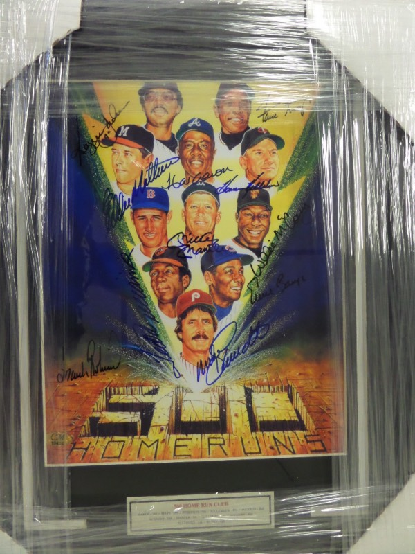 "This special wall hanging comes to you professionally double matted and wood framed and shows the 1989 Ron Lewis colorful ""Lightning Bolt"" print. It shows, and comes blue sharpie signed by all 11 HOF sluggers, and grades a 10 all over the place. I see autographs from Mickey Mantle, Ted Williams, Banks, McCovey, Mays, Aaron and many more, and value on the Chris Morales forensically approved item is $1500.00."